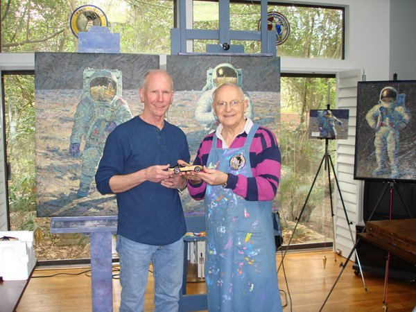 """Above: Left is Danny Reed showing Alan Bean, in his art studio, the Franklin Mint 1:24 1969 Corvette Apollo 12 Coupe model. Speaking about his artistic talent, Alan writes, """"Our time on the Moon ended much too quickly and, in the years since then, I have created paintings to try to capture the feeling of our Apollo 12 mission, as well as all the other Apollo missions, too. It's my hope that these paintings will help other people share in the great adventure. The Gallery will make the sharing easier than ever before."""" To see some of his incredible artwork go his website: http://www.alanbeangallery.com/"""