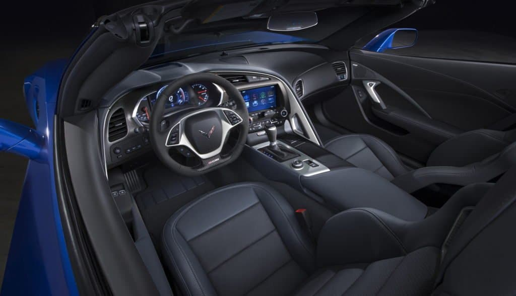 2015 Corvette Z06 Convertible Interior The Z06 benefits from interior details designed for high-performance driving, first introduced on the Stingray, including a steel-reinforced grab bar on the center console for the passenger and soft-touch materials on the edge of the console, where the driver naturally braces during high-load cornering.