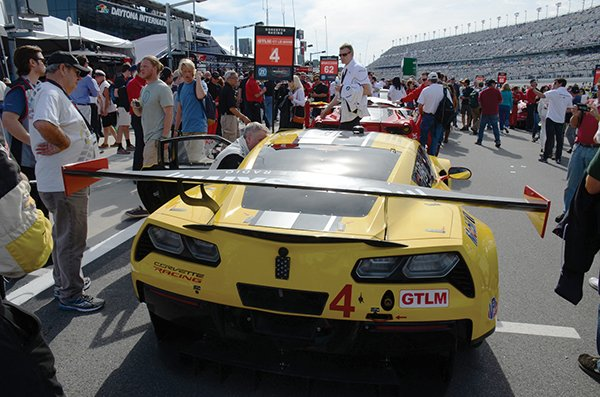 Drivers of the #4 Chevrolet Corvette Racing C7.R, celebrate their victory in the GTLM class Sunday, January 30, 2016, after winning the Rolex 24 at Daytona WeatherTech SportsCar Championship endurance race at Daytona International Speedway in Daytona Beach, Florida. The #3 Chevrolet Corvette Racing C7.R, finished 2nd.