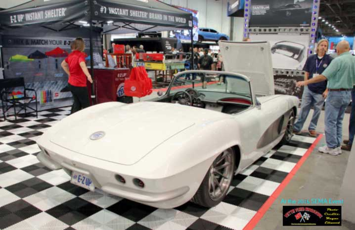 EZ-UP CANOPIES DISPLAYED A CUSTOM 1961 CORVETTE