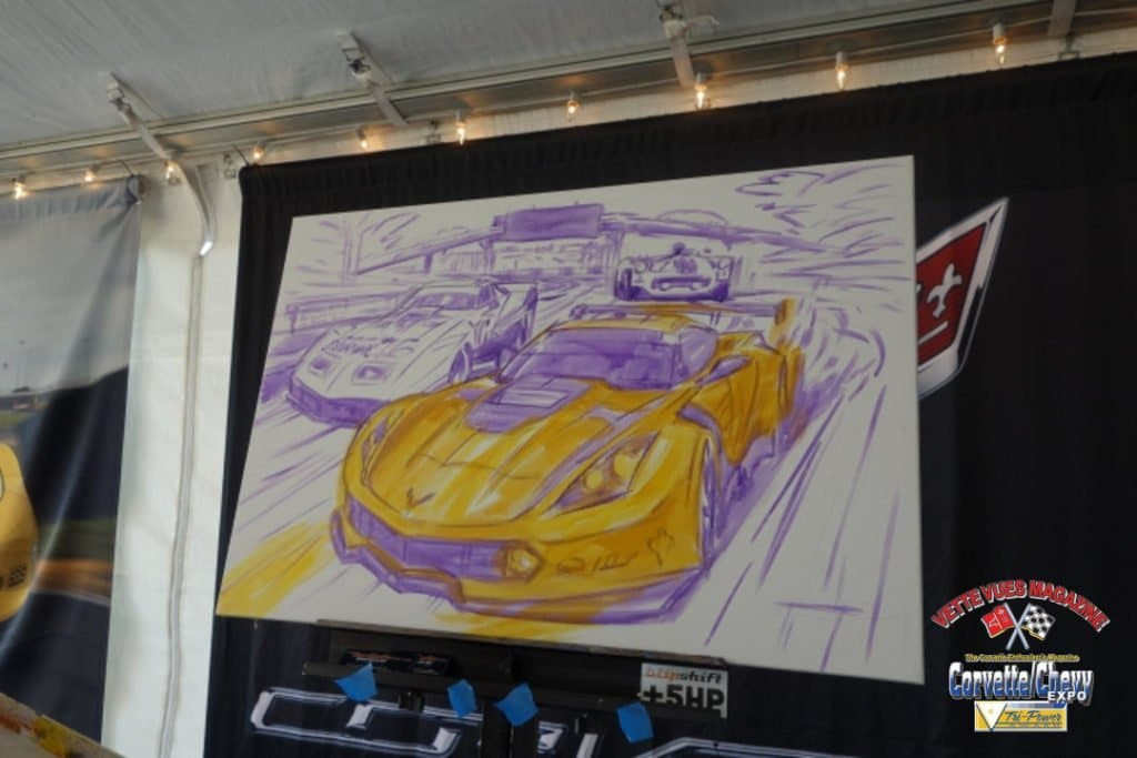 Roger Warrick starting his Corvette Painting to be auctioned off later in the day.