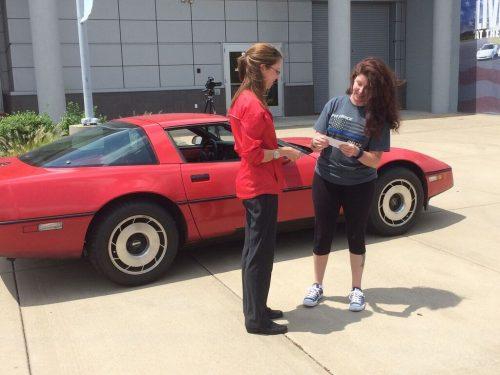 Melissa Rhoads delivers her late husband Burke Rhoads' 1984 Corvette Corvette to the Museum.