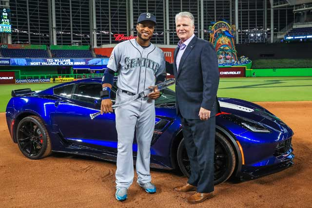 Chevrolet U.S. Vice President Brian Sweeney (right) presents 2017 Ted Williams All-Star Game Most Valuable Player Robinson Cano, of the Seattle Mariners, with a Chevrolet Corvette Grand Sport during the MVP award ceremony Tuesday, July 11, 2015, at Marlins Park in Miami, Florida. Cano was given a choice between the 460-horsepower Corvette Grand Sport and a trail-ready Chevrolet Colorado ZR2. Chevrolet is the Official Vehicle of Major League Baseball. (Photo by Mike Ehrmann/MLB Photos via Getty Images)