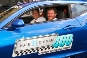 Dale Earnhardt Jr., driver of the #88 Nationwide Chevrolet for Hendrick Motorsports, and General Motors Executive Vice President Mark Reuss drive out in the Pure Michigan 400 Camaro ZL1 Pace Car Thursday, August 10, 2017 at the General Motors Renaissance Center Global Headquarters in Detroit, Michigan. (Photo by John F. Martin for Chevrolet)