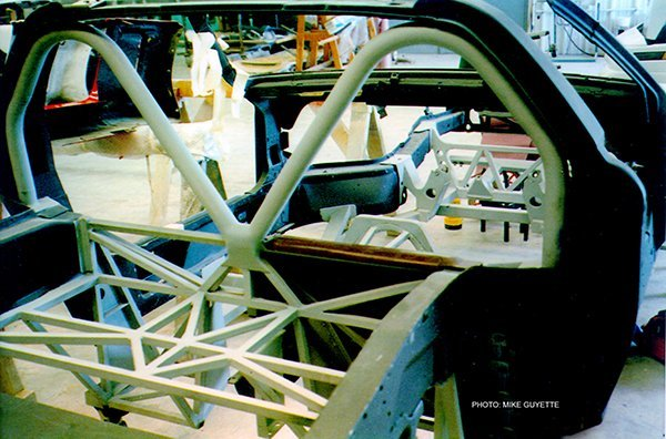 The roll hoops and cross –bracing in the trunk area perform much like a regular cage for racing.