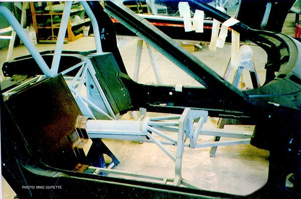 A cross-brace and driveline hoop under the passenger compartment could provide both strength and safety.