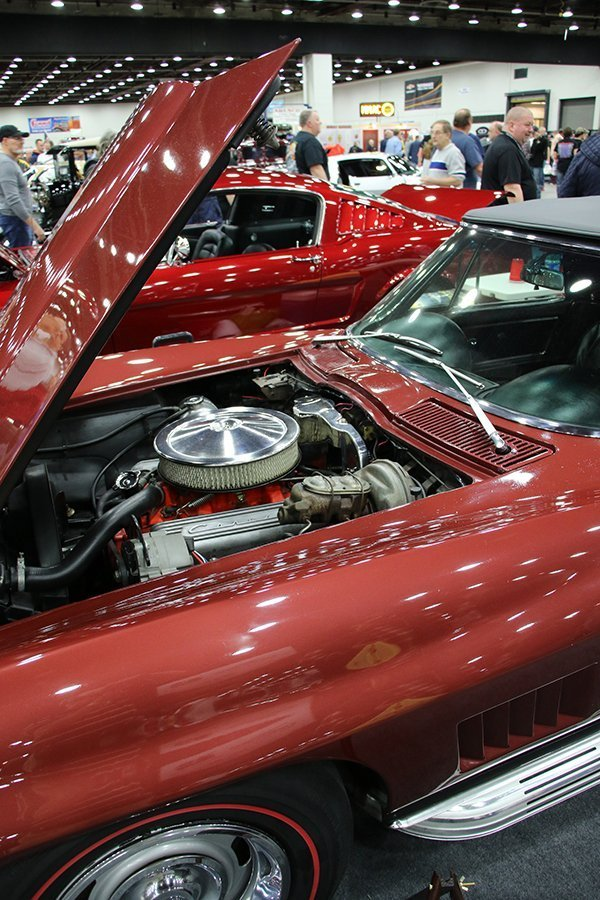 Sal Distefano, from Taylor (MI), calls his red 1967 Corvette coupe BAD DOG. It runs a 396 small block with Sniper fuel injection (carb-style), a 5-speed TREMEC transmission and hydraulic clutch. Redline tires and side pipes. The brakes are Wilwood on 13 inch drilled brake rotors. The ride is controlled and quite amenable, due to coil-overs front and rear. Wheels are 17 x 7 Ridler Wheels. It was all put together at Jack's Speed Shop.