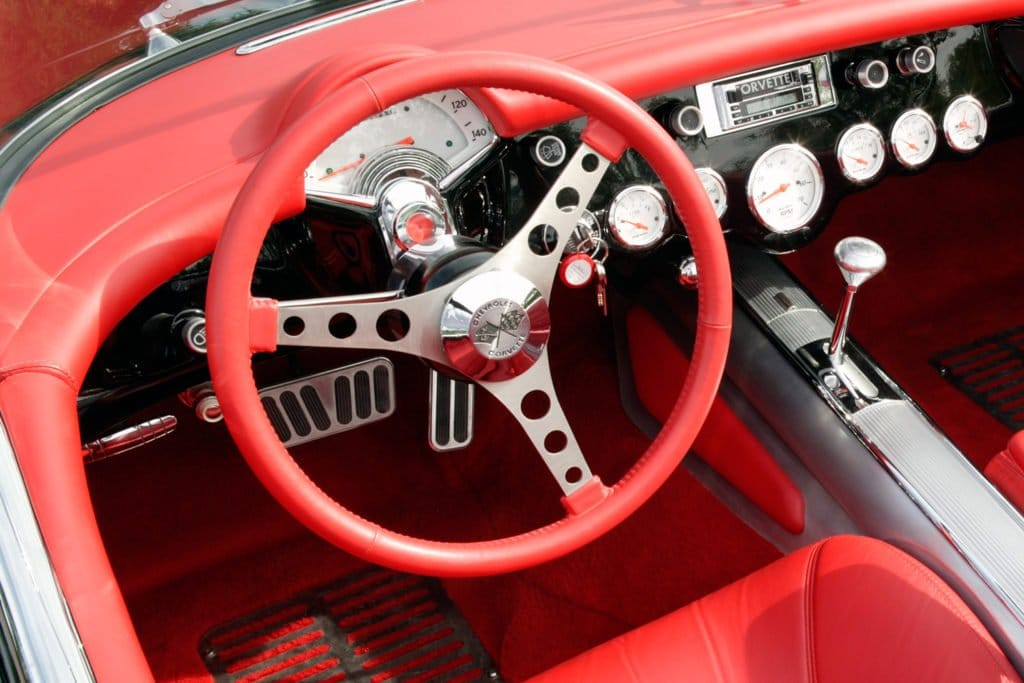 Starting in 1956, the Gen One wheel took on a purposeful look with bored-out, brushed-metal spokes. This example is shown with aftermarket padding and other instrument panel modifications.