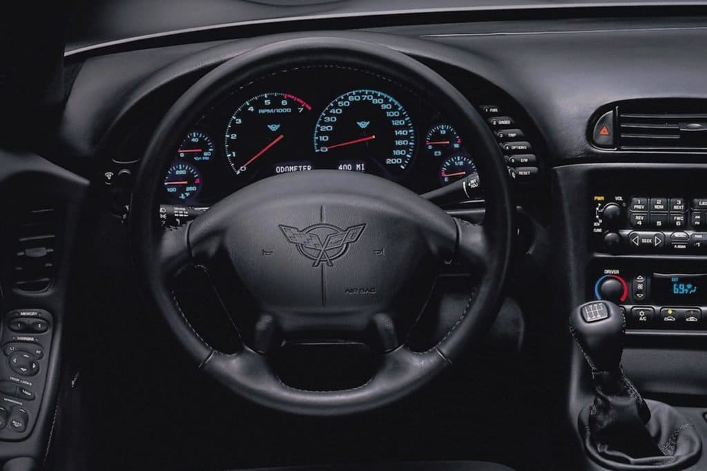 "The black Gen Five wheel was dominated by a large air bag with the word ""Corvette"" embossed into the air bag surface. It featured a four-spoke design."
