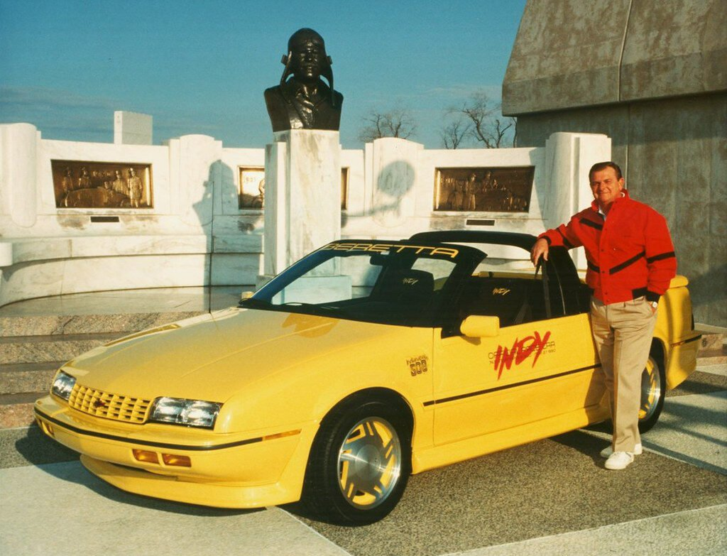 Jim Perkins, then Chevrolet General Manager, poses here with one of the specially-made Beretta convertibles he drove to pace the race in 1990. This was one of three years he drove the pace car at Indy, the other cars being a Camaro and a Corvette