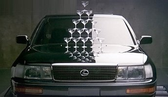 """The award-winning, oft-emulated Lexus introductory ad, """"Balance."""" Created by Team One advertising, this advertisement introduced the Lexus brand and its new LS 400 flagship to a worldwide audience. The ad showed an LS 400 on rollers, with the engine set to full speed. Despite the fast speed, the LS 400 engine produced nary a vibration to upset the champagne glasses stacked on its hood. The narration read, """"After years of intense work, Lexus is ready to celebrate...because even at the equivalent of 145 miles per hour, the Lexus LS 400 is designed to stir the soul...and not much else.""""  This ad was challenged by consumer advocates, who suggested that Lexus had staged the advertisement in some way unseen to the audience. In response, Lexus produced a third-party verification videotape, and performed a live, public demonstration of the same feat--showing that indeed the LS 400 could perform as promised.  The stacking of champagne glasses was also repeated at several auto shows as part of Lexus' 1989 debut."""
