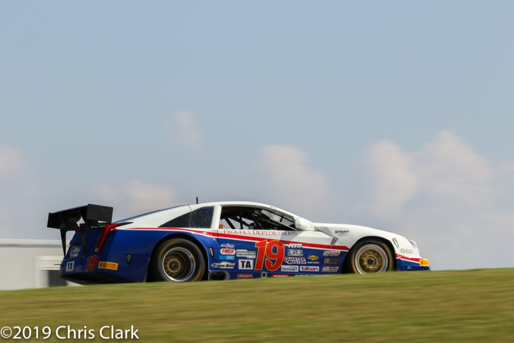 """Corvette legend, Kerry Hitt, 73 wins the """"old man"""" award.  The aerodynamic Caddy created by his company ACP (Advanced Composite Products) in 2017 was a new path from Corvette bodies sold exclusively by Derhaag.  Shown here is #19 at the Trans Am at the Circuit of Americas."""