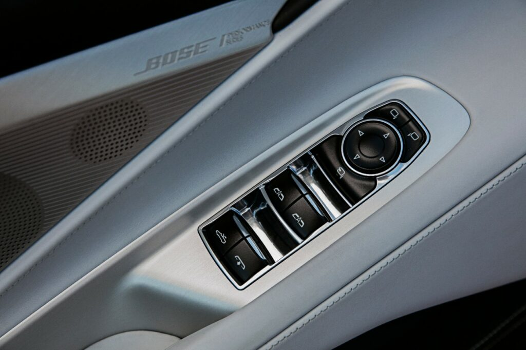 Here is a photo of the 2020 Corvette Stingray Convertible Control Buttons.  You have the up and down convertible roof switches, and above that we find a switch to control the rear window.