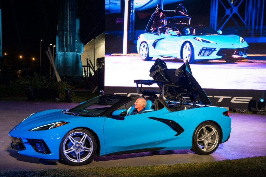Corvette Executive Chief Engineer Tadge Juechter drives the 2020 Chevrolet Corvette Stingray convertible onto the stage during its debut Wednesday, October 2, 2019 at the Kennedy Space Center in Cape Canaveral, Florida. The Corvette Stingray convertible is the first hardtop and mid-engine convertible in Corvette history. The hardtop convertible offers the same storage as the Corvette Stingray coupe, even with the top down. The convertible will be priced only $7,500 (U.S.) more than the entry 1LT Stingray coupe. (Photo by Preston Mack for Chevrolet)