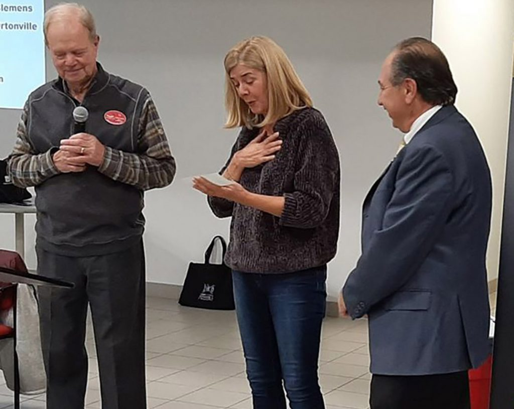 Americas Corvette Club presented a check for $7,000 to SCAMP of Clarkston from the Corvettes America show Silent Auction proceeds. Corvettes America Show Chair Ed Osterman and Bowman Chevrolet rep Sam Mona presented a check to Aimee Baker from SCAMP.