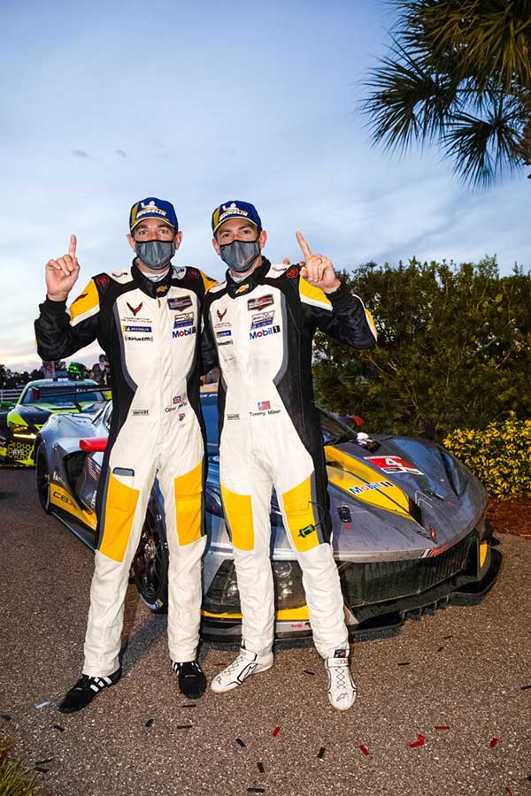 Oliver Gavin (left) and Tommy Milner, drivers of the #4 Mobil 1/SiriusXM Chevrolet Corvette C8.R, celebrate their victory Saturday, July 18, 2020 after winning the 2020 IMSA WeatherTech SportsCar Championship Cadillac Grand Prix of Sebring at Sebring International Raceway in Sebring, Florida. This is the first IMSA race of the season with fans socially distanced at the racetrack, as a result of the COVID-19 pandemic. (Photo by Richard Prince for Chevy Racing)