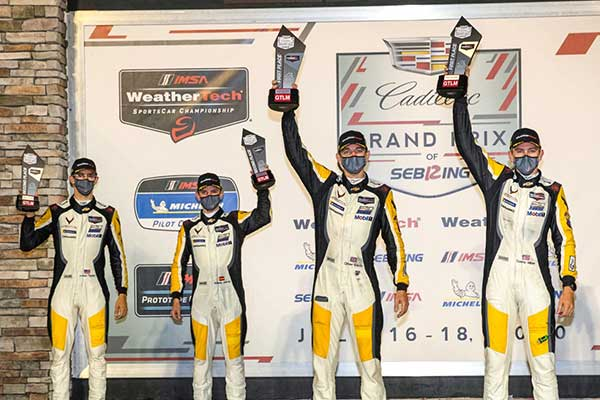 Jordan Taylor (l to r) and Antonio Garcia, drivers of the #3 Mobil 1/SiriusXM Chevrolet Corvette C8.R, and Oliver Gavin and Tommy Milner, drivers of the #4 Mobil 1/SiriusXM Chevrolet Corvette C8.R, celebrate Saturday, July 18, 2020 after Gavin and Milner won the 2020 IMSA WeatherTech SportsCar Championship Cadillac Grand Prix of Sebring at Sebring International Raceway in Sebring, Florida. Taylor and Garcia finished in second place. This is the first IMSA race of the season with fans socially distanced at the distanced at the racetrack, as a result of the COVID-19 pandemic. (Photo by Richard Prince for Chevy Racing)