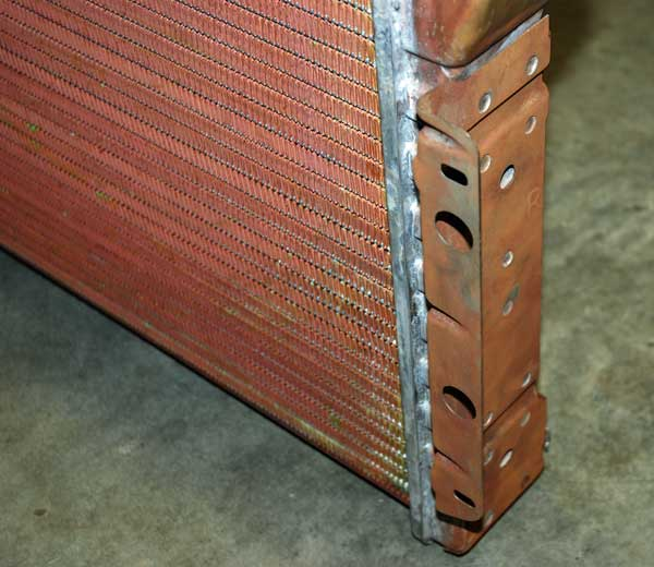 Copper-brass radiators were built with four different materials.  The copper tubes are bonded to the fin with solder (lead), and that has very (Very) poor heat transfer properties. The tanks are made of brass, and the side channels are steel.