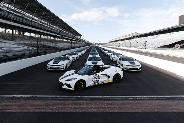 2021 Corvette Stingray Indy 500 Pace Car with the Camaro Festival cars behind it - Image Via Team Chevy
