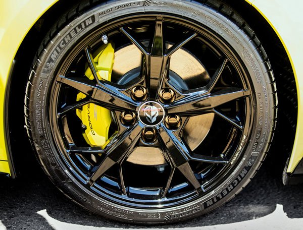 The 2022 Chevy Corvette Championship Edition comes with yellow brake calipers, black Trident wheels with the Corvette Racing 'Jake' logo on the center caps.