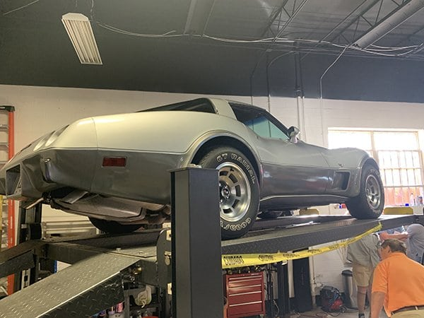 A beautiful low mile 1978 Corvette owned by Tom Beuglas was put up on a lift, and NCRS Region IV Director John Ballard conducted the general presentation.