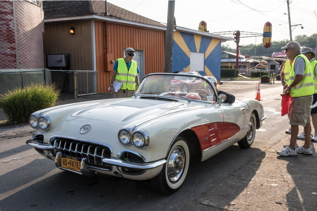 Here is a beautiful early Corvette in white with the red coves.