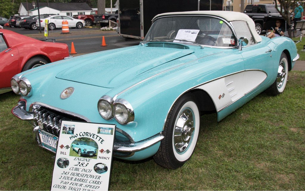 Here is a beautiful 1960 Corvette with the 283 Cubic Inch 345 horsepower, 2 four barrel carbs and the t-10 four speed transmission.  The Tasco Turquoise with white coves is always a classic look!